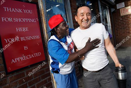 James Oh, Ray-Ray James Oh, right, owner of Tom's Liquors at the intersection of Florence and Normandie, mingles with customer Ray-Ray, in Los Angeles. The retired U.S. Army veteran decided he was not only going to make a living there but make a difference while erasing the stereotype many residents had of Korean-American businesspeople