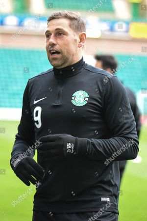Hibs' Grant Holt warms up ahead of the Ladbrokes Scottish Championship match between Hibernian and Raith Rovers at Easter Road, Edinburgh