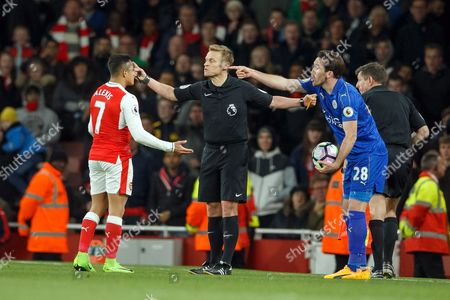 Referee Mike Jones sends Alexis Sanchez of Arsenal away after Christian Fuchs of Leicester City throws a ball at him during the Premier League match between Arsenal and Leicester City played at The Emirates Stadium, London on 26th April 2017