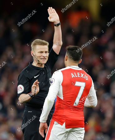 Referee Mike Jones talks to Arsenal's Alexis Sanchez during the English Premier League soccer match between Arsenal and Leicester City at the Emirates Stadium in London