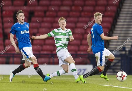 Calvin Miller of Celtic crosses the ball between Aidan Wilson & Ross McCrorie of Rangers during the Scottish FA Youth Cup Final between Celtic & Rangers at Hampden Park on 26th April