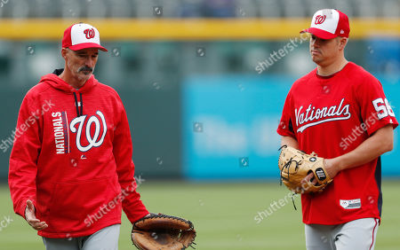 Mike Maddux, Joe Blanton Washington Nationals pitching coach Mike Maddux, left, confers with relief pitcher Joe Blanton as Blanton warms for the team's baseball game against the Colorado Rockies, in Denver