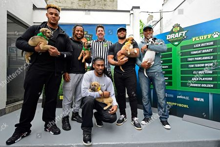 """Dion Dawkins, Najee Goode, Tommy Gimler, Mychal Kendricks, Terrell Watson, Ron Brooks IMAGE DISTRIBUTED FOR DISCOVERY COMMUNICATIONS - Dion Dawkins, recent offensive tackle for the Temple Owls and NFL draft prospect, from left clockwise, Najee Goode, Philadelphia Eagles linebacker, Tommy Gimler, referee and host, Mychal Kendricks, Philadelphia Eagles linebacker, Terrell Watson, Philadelphia Eagles running back, and Ron Brooks, Philadelphia Eagles cornerback, pose for a photo at the Morris Animal Refuge in Philadelphia. Animal Planet and Morris Animal Refuge hosted an adoption event to the public with a mock NFL """"draft."""" With the help from over 150 attendees, current Philadelphia Eagles NFL players evaluated and chose their team lineup amongst adoptable animals. All 14 puppies were adopted"""