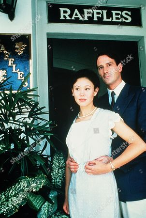 'Tanamera - Lion of Singapore' - TV - John Dexter (Christopher Bowen) Andjulie Soong (Khym Lam) stand outside the Raffles Nightclub