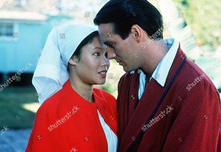 'Tanamera - Lion of Singapore'   TV The Patient John Dexter (Christopher Bowen) recieves close attention from nurse Julie Soong (Khym Lam)