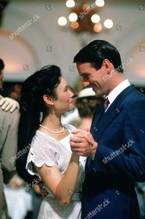 'Tanamera - Lion of Singapore' - TV - John Dexter (Christopher Bowen) and  Julie Soong (Khym Lam) enjoy a dance together