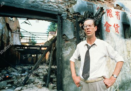 'Tanamera - Lion of Singapore' - TV - Hammond (Brian Spence) stands beside a burnt out house