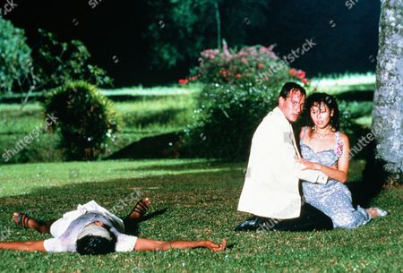 'Tanamera - Lion of Singapore' - TV - John Dexter (Christopher Bowen) comforts Julie Soong (Khym Lam) as a Tamil bandit lies dead next to them