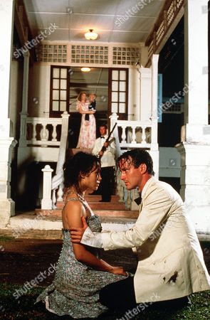 'Tanamera - Lion of Singapore' - TV - John Dexter (Christopher Bowen) Comforts Julie Soong (Khym Lam) in the foreground as Tony (Gary Sweet) holds a rifle and Irene (Louise Lambert) holds their young child