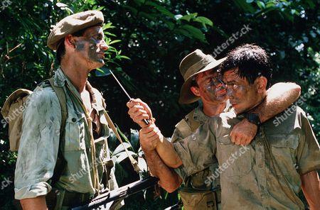 'Tanamera - Lion of Singapore' TV - John Dexter (Christopher Bowen) has a knife pointed at him
