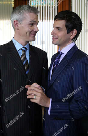 Stock Image of 'Emmerdale'   TV   Soap   -   2008 Pictured:  Paul Lambert (Mathew Bose) and Jonny Foster (Richard Grieve) sneak off and secretly get married in a registry office. They ask Emily Kirk (Kate McGregor) to be a witness along with Barry (Joe Mills).