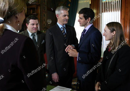 Stock Photo of 'Emmerdale'   TV   Soap   -   2008 Pictured:  Paul Lambert (Mathew Bose) and Jonny Foster (Richard Grieve) sneak off and secretly get married in a registry office. They ask Emily Kirk (Kate McGregor) to be a witness along with Barry (Joe Mills).