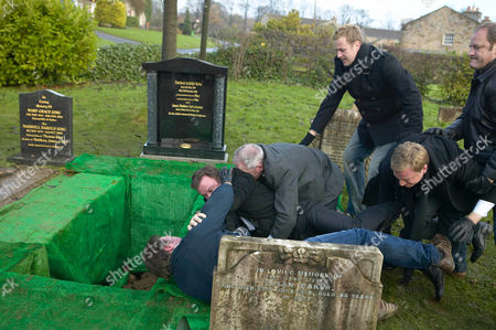 'Emmerdale'   TV   Soap   -   2008 Pictured: Grayson Sinclair (Christopher Villiers) and Matthew King (Matt Healy) fight at Rosemary's grave despite Carl King (Tom Lister), Jimmy King (Nick Miles), Charles Vaughn (Richard Cole), Alisdair Sinclair (Raymond Coulthard) and Perdita Hyde-Sinclair (Georgia Slowe) trying to keep them apart.