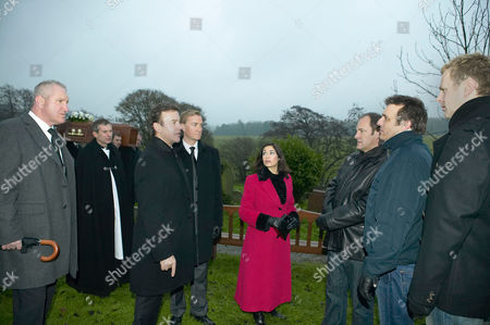 'Emmerdale'   TV   Soap   -   2008 Pictured: Ashley Thomas (John Middleton), Grayson Sinclair (Christopher Villiers), Perdita Hyde-Sinclair (Georgia Slowe) and Charles Vaughn (Richard Cole) are surprised to find Matthew King (Matt Healy), Jimmy King (Nick Miles) and Carl King (Tom Lister) blocking the way to Rosemary's grave in protest at her being burried with their father.