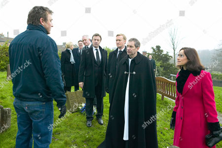 'Emmerdale'   TV   Soap   -   2008 Pictured: Ashley Thomas (John Middleton), Grayson Sinclair (Christopher Villiers), Perdita Hyde-Sinclair (Georgia Slowe) and Charles Vaughn (Richard Cole) are surprised to find Matthew King (Matt Healy) blocking the way to Rosemary's grave.