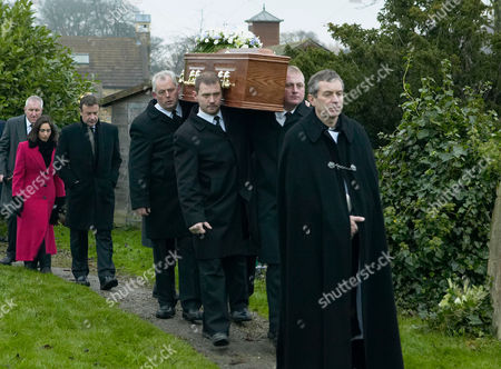 'Emmerdale'   TV   Soap   -   2008 Pictured: Ashley Thomas (John Middleton) leads Rosemary's coffin out followed closely by Grayson Sinclair (Christopher Villiers), Perdita Hyde-Sinclair (Georgia Slowe) and Charles Vaughn (Richard Cole).
