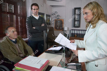 Stock Photo of 'Emmerdale'   TV   Soap   -   2008 Pictured:  Nicola De Souza (Nicola Wheeler) is annoyed at Donald De Souza (Michael Jayston) treating her like a servant. Miles De Souza (Ayden Callaghan) enjoys seeing her squirm for a change.