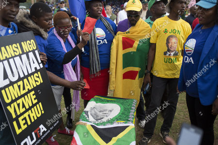Protesters carry a mock coffin as civil society, political parties and church leaders under the banner of the Freedom Movement gather in protest against President Jacob Zuma, Pretoria, South Africa, 27 April 2017. The 27th of April is Freedom Day in South Africa, a public holiday that commemorates and celebrates South Africa?s first democratic elections on this day in 1994. The Freedom Movement is calling for the resignation of the African National Congress (ANC) backed President Zuma. Zuma has said he will not resign following calls from opposition parties, public officials and the public to do so. This follows mass action across the country two weeks ago in most major cities after President Zuma fired members of the cabinet including Finance Minister Pravin Gordhan, sending the local currency, the Rand, to new lows against the US dollar.