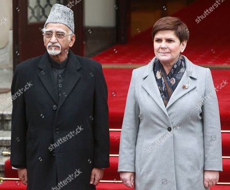Beata Szydlo, Mohammad Hamid Ansari Polish Prime Minister Beata Szydlo, right, receives Indian Vice-President Mohammad Hamid Ansari during a welcome ceremony in front of the Office of the Prime Minister in Warsaw, Poland