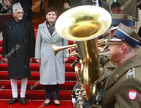 Beata Szydlo, Mohammad Hamid Ansari Polish Prime Minister Beata Szydlo, center, receives Indian Vice-President Mohammad Hamid Ansari during a welcome ceremony in front of the Office of the Prime Minister in Warsaw, Poland