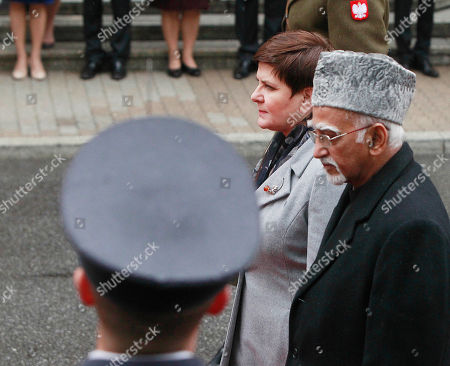 Beata Szydlo,Mohammad Hamid Ansari Polish Prime Minister Beata Szydlo receives Indian Vice-President Mohammad Hamid Ansari,right, during a welcome ceremony in front of the Office of the Prime Minister in Warsaw, Poland