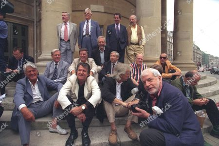 Fifteen Of The Original Radio 1 Dj's Line-up On The Steps Of All Soul's Church Central London This Morning (friday) In A Recreation Of The Original Publicity Photograph Taken 30 Years Ago That Launched The New Station. (l-r) Back Row: Tony Blackburn Jimmy Young Robin Scott (1st Controller)scott Died February 2000. Duncan Johnson (squatting) Dave Cash And Pete Brady; Middle Row: Bob Holness Terry Wogan Keith Skues Chris Stenning And Pete Myers; Front Row: Pete Murray Ed Stewart Pete Drummond Mike Ahern And John Peel (died 25 October 2004) . Those Missing From The Original Picture Are Barry Aldiss Kenny Everett And Mike Paven All Deceased; Mike Lennox Johnny Moran Dave Rider And David Symonds Who Were Not Able To Attend.
