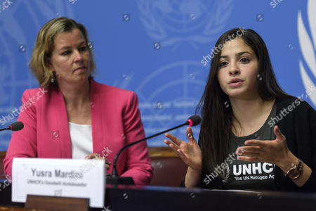 Kelly T. Clements, left, United Nations Deputy High Commissioner for Refugees and Yusra Mardini, right, UNHCR Goodwill Ambassador, speaks to the media about the Appointment of Syrian refugee and Olympic athlete Yusra Mardini as UNHCR Goodwill Ambassador during a press conference, at the European headquarters of the United Nations in Geneva