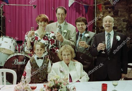 Emmerdale villagers gather for Jack and Sarah's wedding reception - with Jack Sugden, as played by Clive Hornby ; Sarah Connolly, as played by Madeleine Howard ; Annie Kempinski, as played by Sheila Mercier ; Joe Sugden, as played by Frazer Hines ; Amos Brearly, as played by Ronald Magill. (Ep 1870 - 19th May 1994).