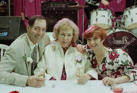 Emmerdale villagers gather for Jack and Sarah's wedding reception - with Jack Sugden, as played by Clive Hornby ; Sarah Connolly, as played by Madeleine Howard ; Annie Kempinski, as played by Sheila Mercier. (Ep 1870 - 19th May 1994).