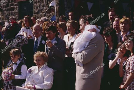 Emmerdale villagers gather for Jack and Sarah's wedding - with Jack Sugden, as played by Clive Hornby ; Sarah Connolly, as played by Madeleine Howard ; Annie Kempinski, as played by Sheila Mercier ; Joe Sugden, as played by Frazer Hines ; Amos Brearly, as played by Ronald Magill and others. (Ep 1870 - 19th May 1994).