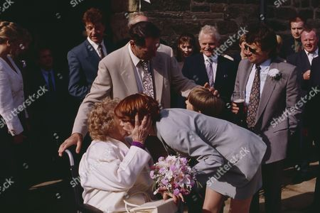 Emmerdale villagers gather for Jack and Sarah's wedding - with Jack Sugden, as played by Clive Hornby ; Annie Kempinski, as played by Sheila Mercier ; Sarah Connolly, as played by Madeleine Howard ; Joe Sugden, as played by Frazer Hines, and others. (Ep 1870 - 19th May 1994).