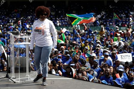 Ndileka Mandela, grand daughter of former South African president Nelson Mandela, leaves the podium after addressing demonstrators during their protest against South African President Jacob Zuma in Pretoria, South Africa, . South Africans are protesting against Zuma, after he dismissed the finance minister fuelling concerns over alleged government corruption and economic weakness