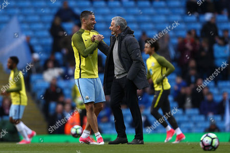 Aleksander Kolarov of Manchester City and Jose Mourinho, manager of Manchester United share a handshake ahead of kick off during the Premier League match between Manchester City and Manchester United played at the Etihad Stadium, Manchester, on 27th April 2017