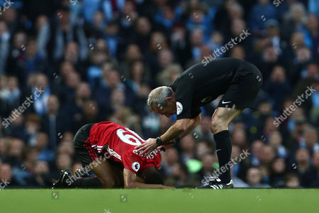 Referee Martin Atkinson checks on Marcus Rashford of Manchester United during the Premier League match between Manchester City and Manchester United played at the Etihad Stadium, Manchester, on 27th April 2017