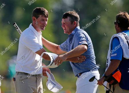 Lucas Glover, Jason Bohn Lucas Glover, left, congratulates Jason Bohn on the ninth green during the first round of the PGA Zurich Classic golf tournament at TPC Louisiana in Avondale, La