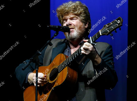 Mississippi country music singer-songwriter, session musician and record producer Mac McAnally performs during the spring meeting luncheon of the Mississippi Economic Council at the state Chamber of Commerce, in Jackson, Miss