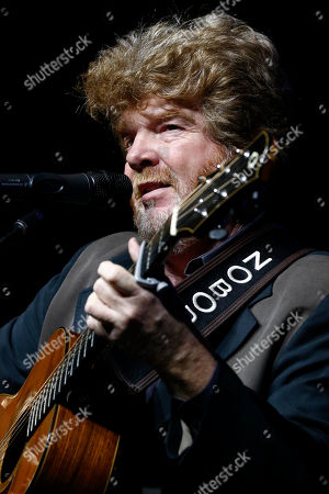 Mississippi country music singer-songwriter, session musician and record producer Mac McAnally sings during the spring meeting luncheon of the Mississippi Economic Council, the state Chamber of Commerce, in Jackson, Miss