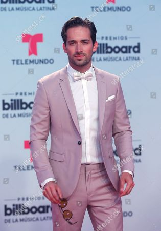 Mauricio Henao arrives at the Latin Billboard Awards, in Coral Gables, Fla