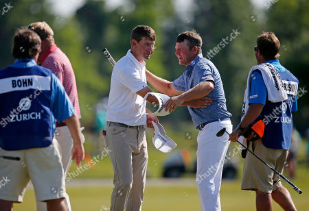 Stock Picture of Lucas Glover, Jason Bohn Lucas Glover, left, congratulates Jason Bohn on the ninth green during the first round of the PGA Zurich Classic golf tournament at TPC Louisiana in Avondale, La