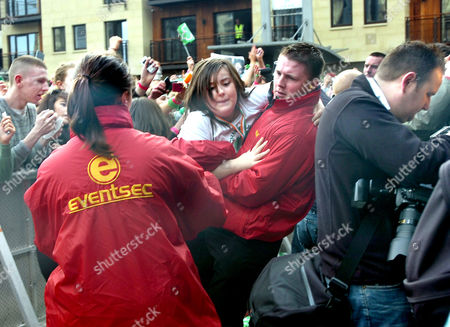 Scores of young girls had to be trailed out of the crush at the front of the St Patricks Day crowd