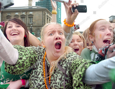 Screaming fans at the front of the St Patricks Day crowd