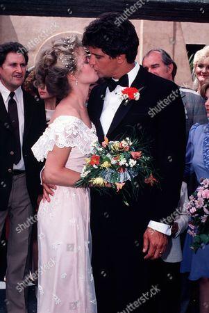 'Policewoman Centerfold' TV - 1983 -  Jennifer Oaks (Melody Anderson) kisses her husband Nick Velano (Ed Marinaro) on her wedding day.