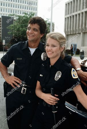 'Policewoman Centerfold' TV - 1983 -  Jennifer Oaks (Melody Anderson) and Nick Velano (Ed Marinaro) pose by their police car.