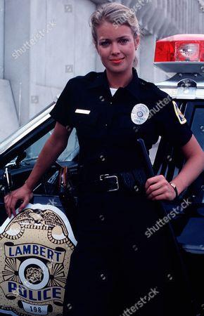 'Policewoman Centerfold' TV - 1983 -  Jennifer Oaks (Melody Anderson) poses by a police car.
