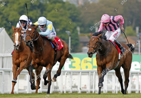 SERENADA (centre, Andrea Atzeni) beats SO SLEEK (right) and SYMBOL (left) in The Nordoff Robbins Sir George Martin Memorial Maiden Fillies Stakes Sandown