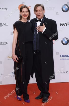German actress Christiane Paul and German actor Martin Feifel (R) arrive on the red carpet for the 67th German Film Awards at the Palais am Funkturm venue in Berlin, Germany, 28 April 2017. The Lola awards are presented in 18 categories.