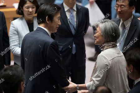 South Korean Foreign Minister Yun Byung-se, left, arrives for a ministerial level Security Council meeting on the situation in North Korea, at United Nations headquarters
