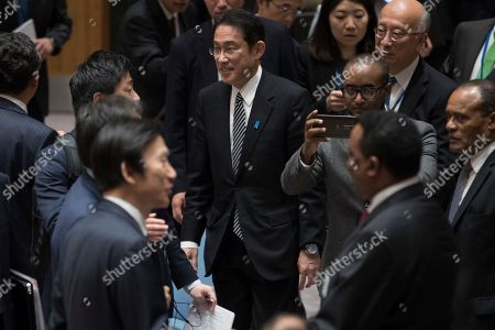 Stock Picture of Fumio Kishida, Yun Byung-se Japan's Foreign Minister Fumio Kishida, center, walks past South Korean Foreign Minister Yun Byung-se, bottom left, as he attends a ministerial level Security Council meeting on the situation in North Korea, at United Nations headquarters