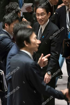 Fumio Kishida, Yun Byung-se Japan's Foreign Minister Fumio Kishida, right, walks past South Korean Foreign Minister Yun Byung-se, bottom left, as he attends a ministerial level Security Council meeting on the situation in North Korea, at United Nations headquarters
