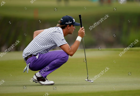 Smylie Kaufman lines up a putt on the 18th green during the second round of the PGA Zurich Classic golf tournament's new two-man team format at TPC Louisiana in Avondale, La